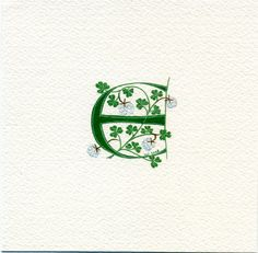 Initial letter  E handpainted in green with white clover (including a four-leaved one for luck!) on high quality watercolor paper and framed