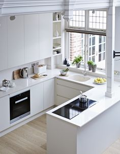 A stylish & contemporary white kitchen - Pure kitchen from John Lewis of Hungerford. https://www.john-lewis.co.uk/kitchens/pure#.VTeyoFo7qfE