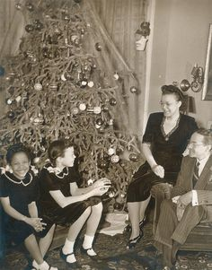Dr. Sadie Alexander, her husband Raymond and daughters, Rae Pace and Mary Elizabeth, during Christmas, 1943. Dr. Alexander was the first African-American woman to receive a PhD. University of Pennsylvania Archives.