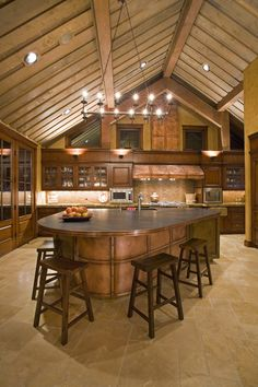 great kitchen, copper panels on curved cabinet and copper kitchen hood
