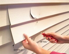 How to Replace Vinyl Siding - Article | The Family Handyman.  Slid zip tool along bottom edge to remove siding. Remove nails. Slide in replacement piece.  Hook upper piece to the replacement piece below until it hooks in place.