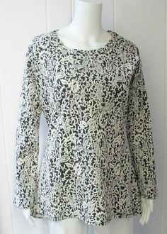 Jaquard Top | You're sure to turn heads in this pretty and feminine jaquard top.  Paisley & floral print.  Scoop neck.  Long sleeve.  52% Cotton/44% Polyester/4% Spandex.  Sizes S-XL. | Willy & Babbish Boutique | New Baltimore, MI