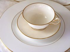 There are 12 pieces each of; dinner plates, salad plates, dessert plates, cups and saucers, of Gold Rimmed WEDGWOOD BONE CHINA . . . VERY OLD & A