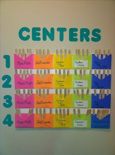 I don't have a self-contained classroom, but I still wanted to be able to efficiently post Centers for my 90 students. Each row is for a different class, with an envelope for the assigned center. The sticks have my student's names on them, which makes for Kindergarten Classroom, Future Classroom, School Classroom, Teaching Math, Classroom Ideas, Classroom Table Names, Bilingual Kindergarten, Classroom Design, Music Classroom
