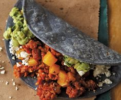 These are easy and satisfying tacos for any time of day, including breakfast. If you can't find Mexican chorizo, which is fresh and uncured, substitute cured Spanish chorizo, but you'll need to finely chop it and sauté it in a little oil.