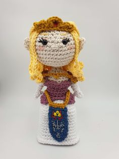 Crochet Amigurumi pattern for Zelda. Complete with crown,armour and warrior tabard. The pattern is available for Zelda alone or as an eBook with a matching Link figure. Single Crochet Decrease, Single Crochet Stitch, Half Double Crochet, Crochet Patterns Amigurumi, Crochet Hooks, Pattern Art, Art Patterns, Aran Weight Yarn, Cat Crafts