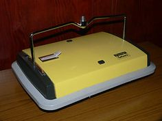 Ewbank Carpet Sweeper. I wish I had one now, they were so useful and easier to use & store than a vacuum