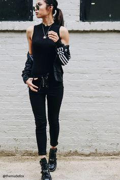 A pair of stretch twill skinny pants featuring a mid-rise, lace-up grommets in the front, and a five-pocket construction.