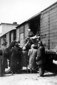 Jews boarding a transport, Dunaszerdahely, Hungary, 1944.