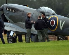 Prince Harry chats to fellow pilotsat The Battle of Britain Flypast...