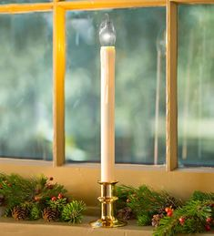 This window candle is cool for many reasons: it's battery-operated with a timer for total ease (no cords!); the special LED faces outward for a bright exterior display; AND, best of all - it's adjustable to fit in any window! LOVE IT! Adjustable Height Window Candle With Outward-Facing LED Bulb