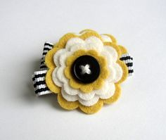 layered felt flowers...& love stripes with single black button