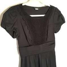 BCBG Max Azria Crochet Too Black Dress Adorable BCBG dress with pleated skirt section and crocheted top. Worn once and dry cleaned! Zips up side. BCBGMaxAzria Dresses