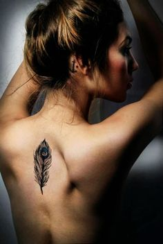 Peacock feather tattoo on back #feather #back #tattoo www.loveitsomuch.com