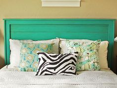 A simple headboard but painted in teal is definately eye catching! This makes for a perfect young couples bed and mixing paterns can be fun!