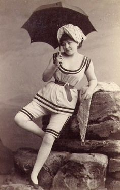 vintage seaside...I think she has her corset on under the swimsuit!