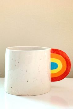 Can you ever have too many coffee mugs? This simple white ceramic mug gets a fun pop of color thanks to a rainbow handle.