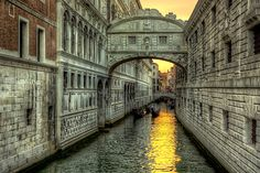 Il Ponte dei Sospiri - The Bridge of Sighs, beautifully carved, enclosed tunnel that arched between the New Prison to the interrogation rooms in the Doge's Palace. The legend is that if two young lovers kissed beneath this bridge at sunset while the bells of St. Mark's were ringing, they would love each other forever.