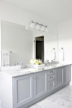 The best paint colour with marble is Benjamin Moore Pigeon Gray as shown on painted vanity by AM Dolce Vita