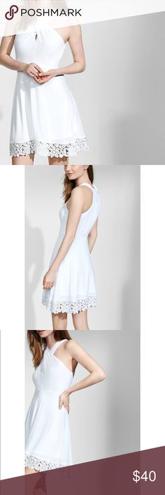 BNWT Express White Crossover Halter Dress With its shoulder-baring crossover neckline, this breezy mini gets a feminine touch from its crocheted floral hemline. The dress is rendered in a polyester blend that has enough structure to keep you comfortable and confident for an all-nighter.  High crossover neckline Sleeveless Hidden side zipper; Fill silky lining Crocheted hem Polyester Machine wash Imported Express Dresses Mini