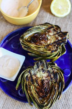 Grilled Artichokes with Lemon Aioli- artichokes, olive oil, sea salt, pepper, lemons, mayo, sriracha sauce, garlic