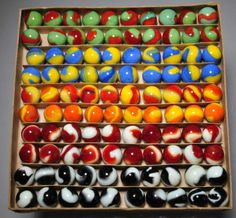 Akro Agate box set of Prize Name Marbles reminds me of the old school way we used to buy marbles when I was a kid. Glass Marbles, Marbles Images, Marble Pictures, Marble Games, Rainbow Shop, Glass Paperweights, Fantasy Jewelry, Glass Ball, Colors