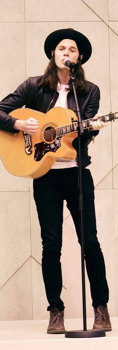 British musician James Bay launches the Burberry S/S15 show with a live performance from the runway