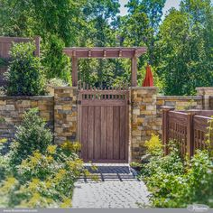 Incredible Walnut PVC Vinyl Privacy Fence, Pergola, and Lattice Illusions Fence. Looks like stained wood fence products without the maintenance.