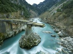 Old bridge of Tsimovo on Arahthos river at Epirus Greece Old Bridges, Old And New, Adventure Travel, Places To Go, Greece, River, Stock Photos, Channel, Outdoor