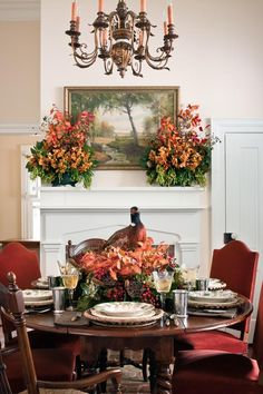 Mantlepiece Arrangement - Fabulous Fall Decorating Ideas - Southernliving. Celebrate the bounty of fall with multiple show-stopping arrangements. Orchids, lotus pods, rose hips, and cattails brighten this dining room.
