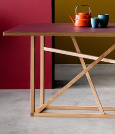 Studiomama has designed an oak trestle for furniture company Another Brand, which can be rotated to make a dining table, a console or a coffee table.