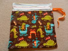 An amazing drawstring toy bag made by my daughter for her nephew