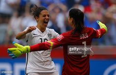 Carli Lloyd #10 of the United States of America celebrates after her third goal against Japan with goalkeeper Hope Solo #1 in the FIFA Women's World Cup Canada 2015 Final at BC Place Stadium on July 5, 2015 in Vancouver, Canada.