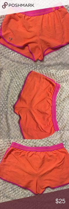 Under Armour  Day Glow Running Shorts EUC Under Armour Running shorts, they have only been worn once. These are a sized Medium, I cut the tag out because I wore them in my first 5k. They are lined, but I would recommend a longer tank because they look sheer. Under Armour Shorts