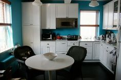 White cabinets, teal walls