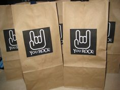 Rock star party gift bags.  Simple brown bag, found the pic on google images, printed, and glued on to bag.