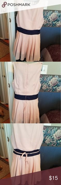 "15% Disc. On Bundle of 3- Jr.M Mauve Dress w/Navy 30"" Bust and 30"" length from shoulder to hem. VERY Sheer chiffon like fabric but fully lined. The NAVY waistband and navy hemline ruffle are such a pretty contrast! There is a tie belt included but has a little fraying as shown in last picture. It looks great without as well as seen in the first picture. Perfect for Summer! Quan mei Dresses Mini"