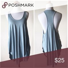 "Silky Smooth Modal Tank Item Description ""Loose fit, sleeveless, scoop round neck tank top. Racerback. Has very rounded hems. This tank top is made with medium weight, sand washed knit fabric that has a very ""silky"" feel, drapes beautifully and stretches very well."" Color is more of a grey blue. It has a cool feel to it - so nice for hot summer days. New, no tags. Purchased directly from the vendor. Five star rated. High quality, expensive feeling material! Tops"