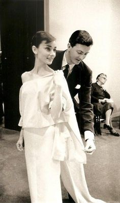 """1956, Hubert de Givenchy adjusts the toile for the costume Audrey Hepburn wears to open the fashion-show sequence in """"Funny Face."""" Photograph by David Seymour/Magnum Photos. PY PI"""