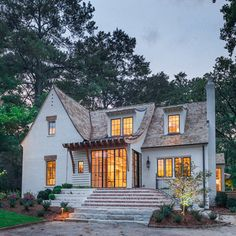 Christopher Architecture + gable style + attic vents + sloped dormers + inset wood detail about window + hints of modern