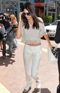 302d61aba0fc Kendall Jenner wearing Miu Miu Metal Cap Toe Sneakers and Creatures of  Comfort Fringe Trim Short