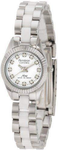 Armitron Women's 75/4034WTSV White Ceramic Swarovski Crystal Accented Silver-Tone Watch Armitron. $53.94. Silver-tone luminous hour hands; Sweep second hand; Printed outside minute track. Silver-tone coin edge bezel. Silver-tone adjustable bracelet with white ceramic center links and a stainless steel fold over buckle. Water-resistant to 165 feet (50 M). White glossy dial with 12 Swarovski crystal markers