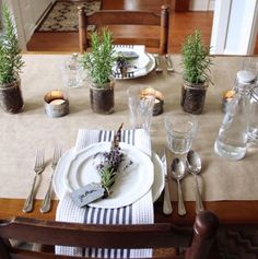 If you're a host who loves to impress in low-key ways, take inspiration from this effortlessly graceful tablescape from Finding Home Online. Rosemary plants in jars offer a centerpiece that feels as though it's home-grown (as it might just be!) and feathers accompany lavender for a delicate place setting.