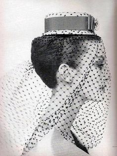 Mary Jane Russell in a hat and veil forHarper's Bazaar, March 1959. Photo by Louise Dahl-Wolfe.