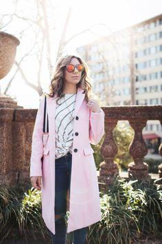 Style Blogger Roxanne Birnbaum of Glass of Glam wearing a SugarLips striped top, AG denim, Amazon Fashion pink coat, a Zaful bag, and Vye Eyewear Sunglasses