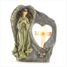 Add a calming presence to your outdoor space with this charming angel garden statue. This beautiful garden angel features a solar powered design that illuminates the pink rose dress and the bird at night. Solar Powered Garden Lights, Solar Led Lights, Outdoor Statues, Garden Statues, Decorative Solar Lights, Garden Angels, Angel Statues, Faux Stone, Lawn And Garden