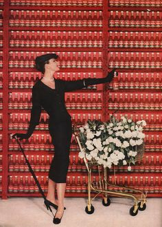 Dovima looking very chic in the ketchup aisle of a supermarket for August Vogue 1956.