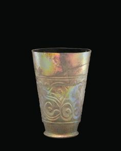 OBJECT NAME  Beaker with Palmettes PLACE MADE  Near East possibly Persia DIMENSIONS  Overall H: 10.5 cm; Rim Diam: 7 cm DATE  about 901-999