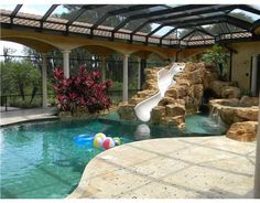 Beautiful indoor pool with a water slide - 6 Athlete Homes With MVP Pools