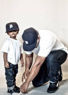 Father and Son? Uncle and Nephew? Whatever their relationship, this is a cute pic. AND they're reppin' The D!! #313